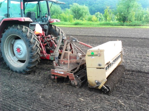 "Different soil types determine which type of machine is used to plant the cover crop.  This machine tills, drops the seed and then compresses it into the surface of the ground.  This is a particularly good way to plant alfalfa on ""heavier"" soils."