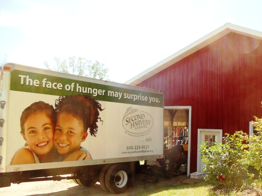 Second Harvest truck backing up to packing shed to load up with produce