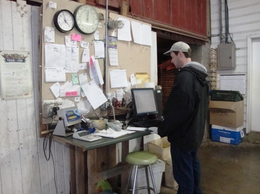 Eric, our packing shed manager, working hard to keep it all organized.