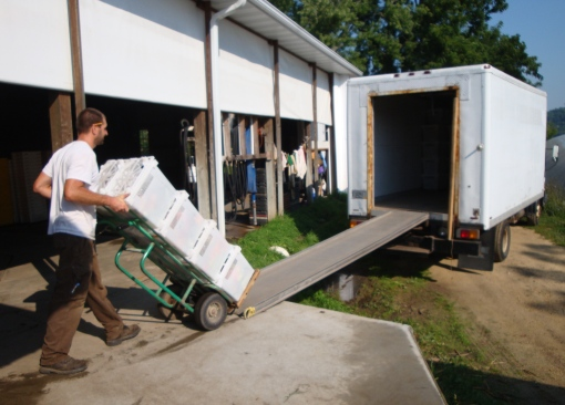 Jesse rolling a pallet of full CSA shares onto one of the trucks.