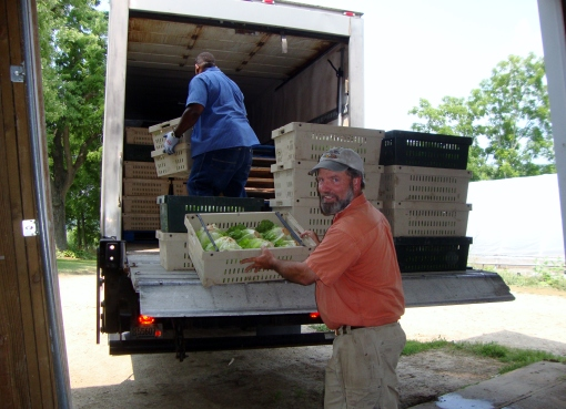 David loading donations onto the Second Harvest truck.