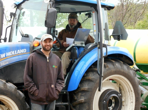 David Perkins (in tractor) and Jesse Perkins (standing). These guys prepare the fields and operate the tractors for transplanting.