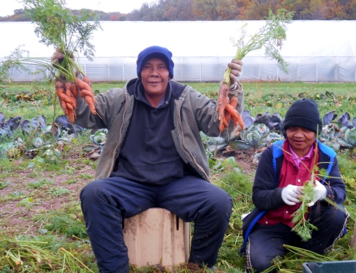 Sophal showing off his favorite carrots. His sense of humor keeps us all laughing.