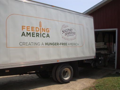 The Second Harvest Food Bank truck getting loaded up with potatoes. So far this year we have donated 12,300 pounds of potatoes to Second Harvest!