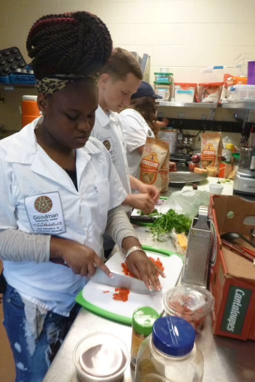 Seed to Table students preparing peppers to make salsa at Goodman Community Center